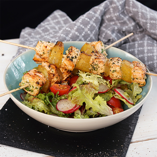 Grilled salmon skewers on tomato & radish salad