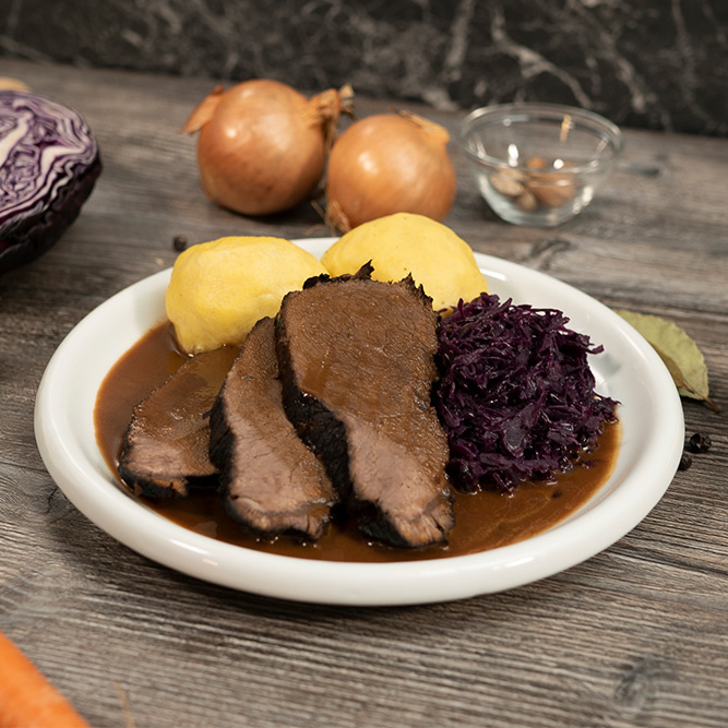 Marinated pot roast with dumplings and red cabbage